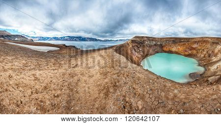 Giant volcano Askja offers a view at two crater lakes. The smaller, turquoise one is called Viti and contains warm geothermal water. The large lake is Oskjuvatn. Panorama