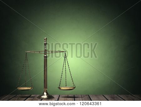 Law scales on wooden desk concept for justice and equality