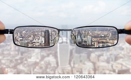 Clear business vision concept businessman looking at the financial district of the city of London