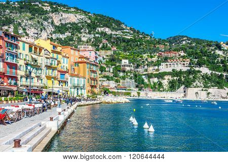 Villefranche-sur-Mer, France - March 3, 2016: Panoramic view of coastline and beach with blue sky luxury resort and bay with yachts Nice port Villefranche-sur-Mer Nice Cote d'Azur French Riviera.