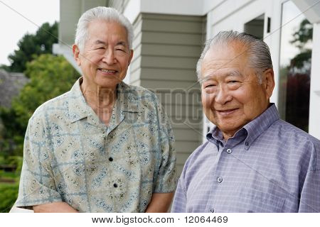 Portrait of two elderly men smiling