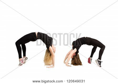 Two women in yoga pose bridge at fitness isolated