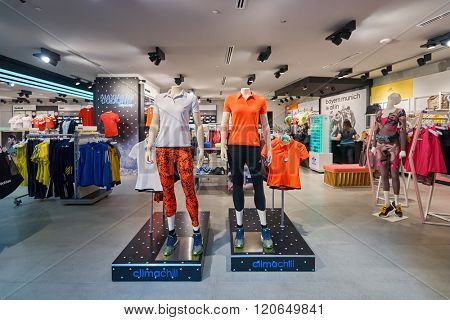 SINGAPORE - NOVEMBER 08, 2015: interior of Adidas store. Adidas AG is a German multinational corporation that designs and manufactures sports shoes, clothing and accessories