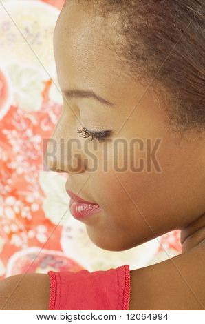Young woman looking over her shoulder