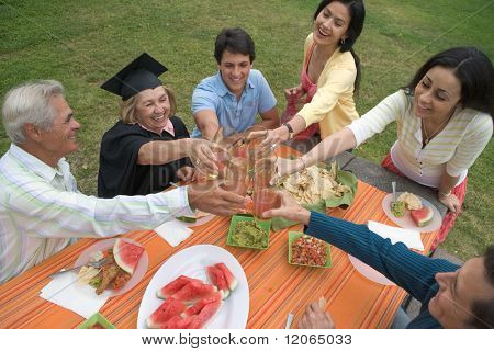 Graduating mother celebrating with family