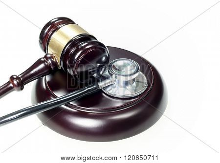 Judge hammer and stethoscope on a white background