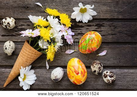 Easter Background With Eggs And Flowers On Wooden Board, Top View