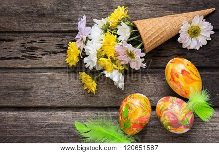 Easter Background With Eggs, Flowers, And Decoration On Wooden Board, Top View