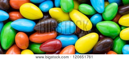 Colorful Background Of Assorted Multicolored Coated Sunflower Seeds, Letterbox Format