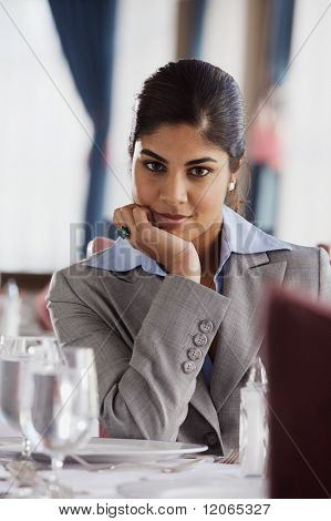Businesswoman smiling for the camera in restaurant