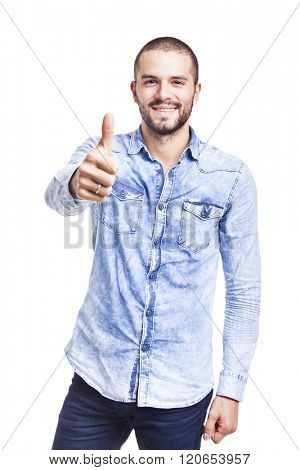 Young casual man thumbs up over white background
