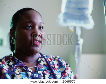 Female nurse adjusting intravenous drip