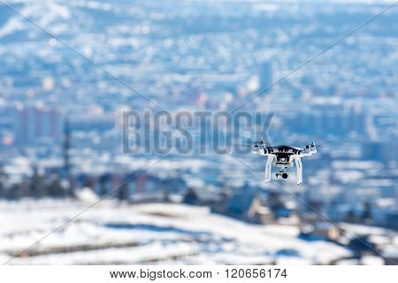 Ulan-Ude, Russia - March 5, 2016: Hovering drone that takes pictures