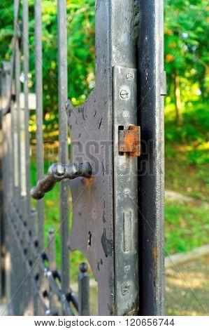 Rusty Lock In The Old Iron Gate