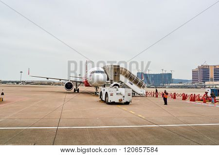 MACAO - FEBRUARY 17, 2016:  Thai AirAsia A320 in Macao International Airport. Thai AirAsia is a joint venture of Malaysian low-fare airline AirAsia and Thailand's Asia Aviation