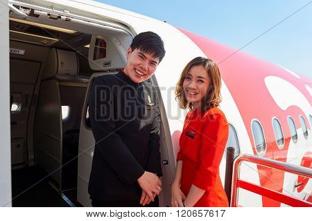 PATTAYA, THAILAND - FEBRUARY 26, 2016: crew members meet passengers of Thai AirAsia. Thai AirAsia is a joint venture of Malaysian low-fare airline AirAsia and Thailand's Asia Aviation