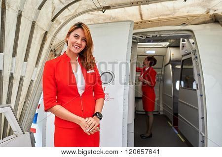 MACAO - FEBRUARY 17, 2016:  crew member meet passengers of Thai AirAsia. Thai AirAsia is a joint venture of Malaysian low-fare airline AirAsia and Thailand's Asia Aviation