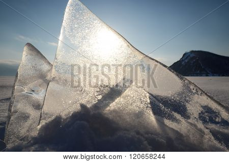 Thin Transparent Ice Floes Against The Sunset Light. Lake Baikal, Russia