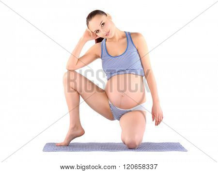 Prenatal exercises. Beautiful pregnant woman exercising. Model practicing yoga, isolated on white.