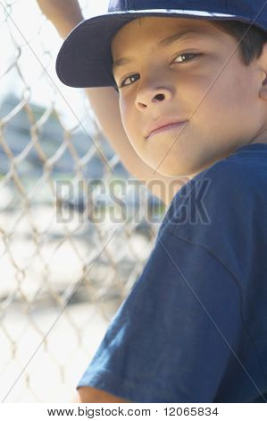 Portrait of boy at baseball game