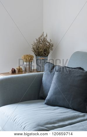 Sofa With Dry Plant Decorated On Side Table