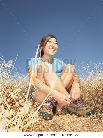 Middle-aged woman smiling in tall grass