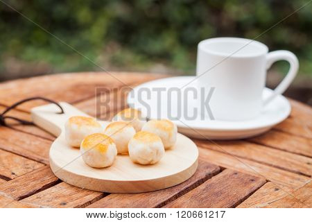 Mini Chinese cakes on wooden plate, stock photo