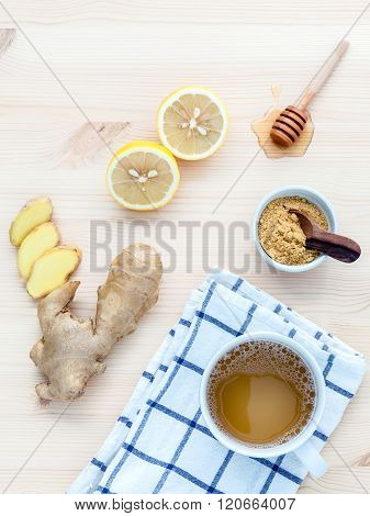 The Cup Of Ginger Tea With Ginger Roots , Ginger Powder ,lemon And Honey  On Rustic Wooden Table.