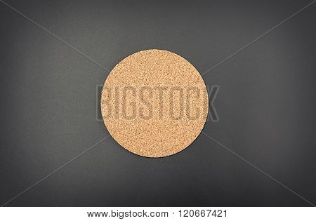 Cork drink coaster on grey background