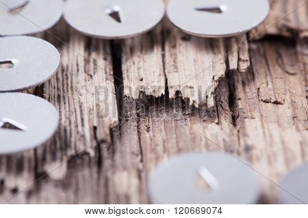 abstract macro image of rotten wooden board  and metal pushpin