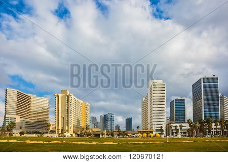 TEL AVIV, ISRAEL - JANUARY 1, 2016: Skyscrapers on Tel Aviv's seafront. Windy and bright winter day at the seaside
