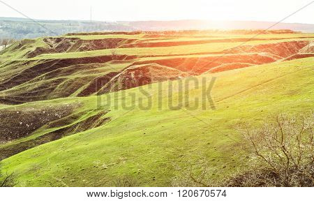 Spring Nature Landscape With Hills And Sun