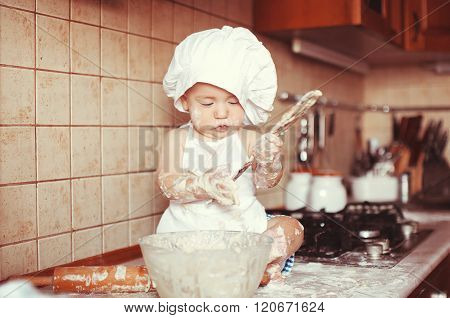 Little Scullion Is Kneading Dough In An Apron And Chef's Hat Sitting In The Flour.