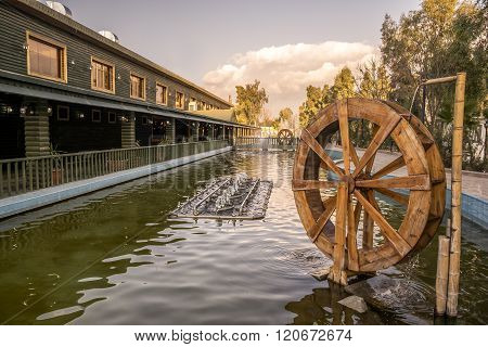 Old Waterwheel In Water