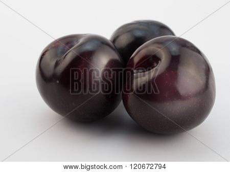 Plums On White