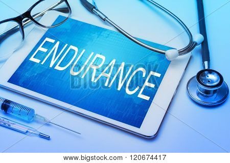 Endurance word on tablet screen with medical equipment