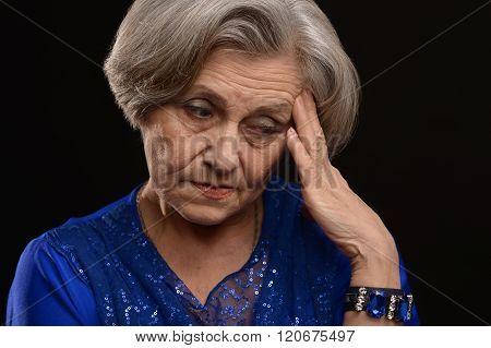 sad an elderly woman
