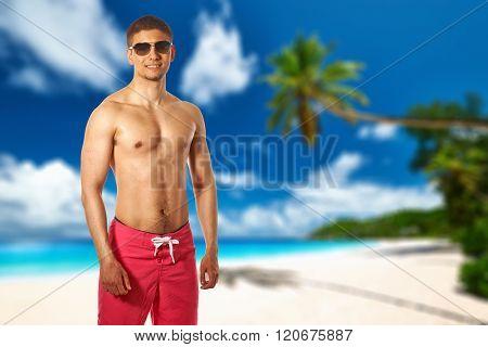 Man on beach Anse Intendance at Seychelles, Mahe. Collage.
