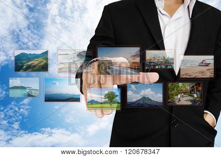 Businessman choosing photo, on digital touchscreen, travel concept and flashback to the past concept