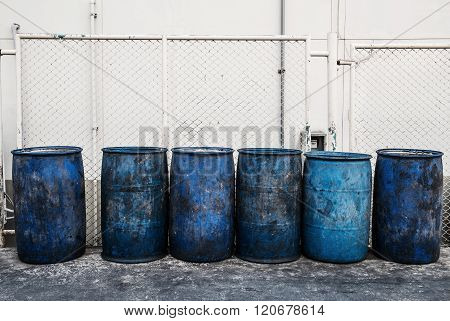 Dirty blue plastic garbage containers