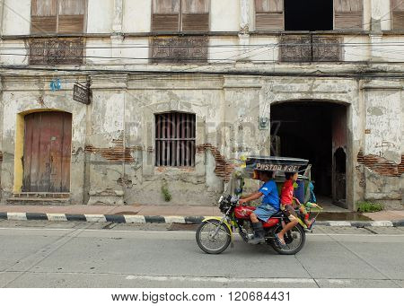 Family On Tricycle Ride In City Of Vigan