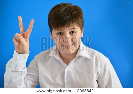 Teen boy holding his finger up, he came up with the idea