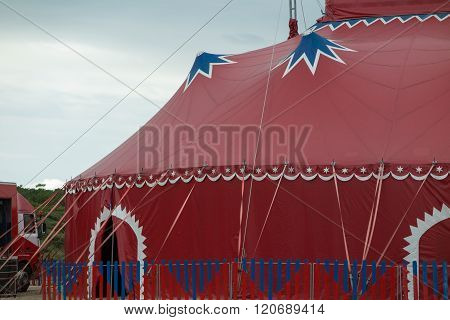 Parts Of A Circus Tent Red, White And Blue Under Cloudy Grey Sky