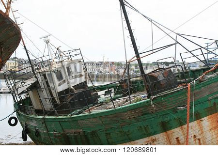 Old And Rusty Desolate Fishing Ship In  Harbour