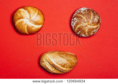 Three Bread Rolls On Red Background
