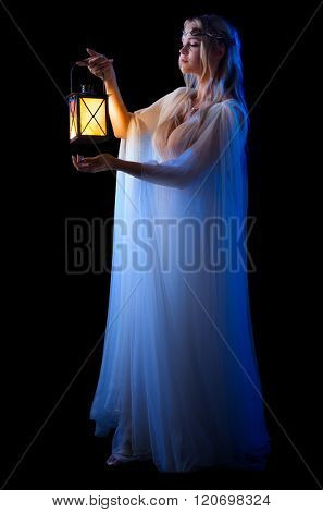 Young elven girl with lantern isolated on black