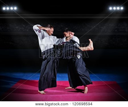 Two aikido fighters at sports hall