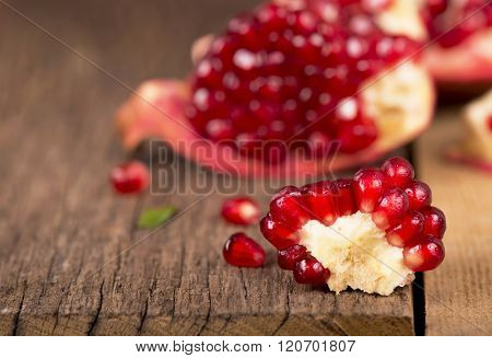 pomegranates on a wooden background