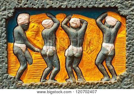 THANJAVUR/INDIA Feb 29th, 2016: Painted sculptor depicting farmers at work in field