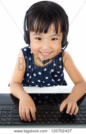 Asian Little Chinese Girl In Headset With Laptop